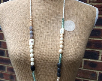 Beaded necklace - multi tonal beads - colours ivorys greens greys - varied shapes and textures - beautiful necklace.