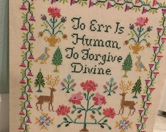 "Vintage embroidery on linen quote ""to err is human to forgive devine"" cross-stitch"