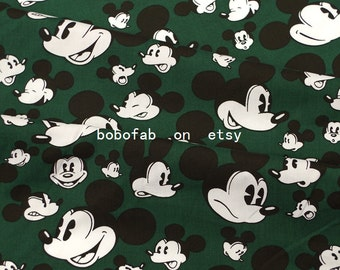 """2332  - 1 yard Cotton Poplin  fabric - Mickey Head on Deep Green (145cmx91.44cm,57""""x36"""")"""