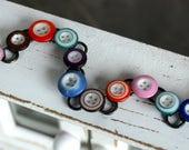 Antique China  Button Bra...