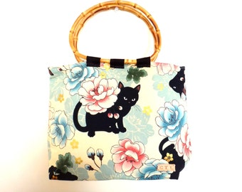 Japanese design black cat and flower tote bag Blue and cream colour Bamboo handles