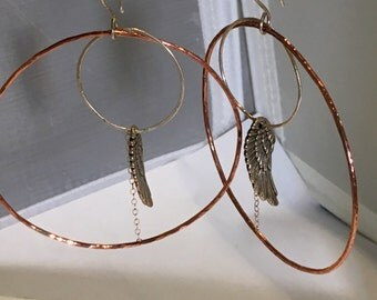 Large winged hoops mixed metal fashionable earrings