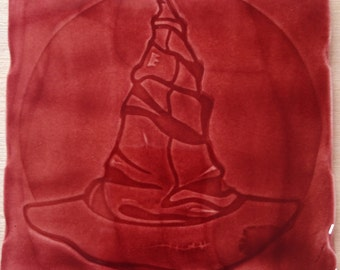 Handmade 'Wizards Hat' design tile In Claret colour glaze,