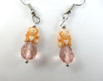 Girl's tiny orange teddy bear earrings