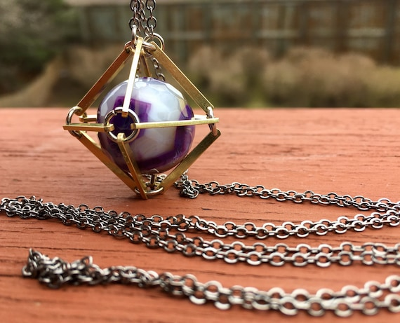 Amethyst Caged In Brass Necklace