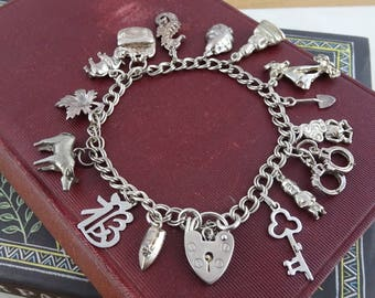 Vintage Sterling Silver Charm Bracelet, Loaded with Unique  1980's Charms,  Hallmarked ASJ Padlock Charm Bracelet