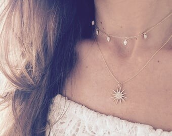 Diamond starburst charm necklaces in  gold one large charm necklace