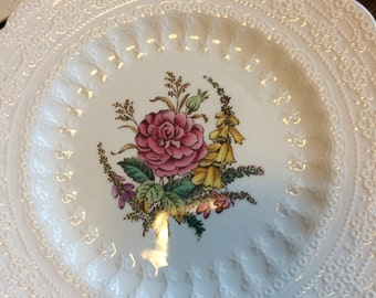 This is a listing for 9 Spode Salad Plates in the Heath and Rose Pattern