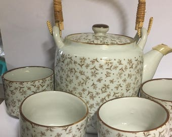 Japanese tea set, adorable teapot and four cups in like new condition, use it, display it, give as a gift