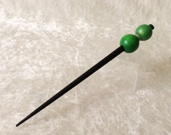 Stylish black hairpin with green pearls