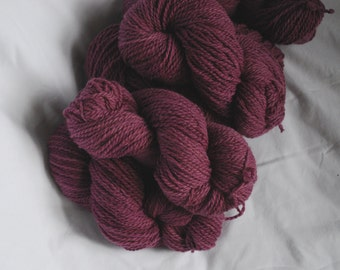 100 g skein aran / heavy worsted weight yarn wool. Naturally hand dyed purple fuchsia with cochineal