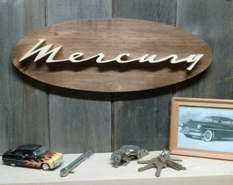 1964 Mercury Emblem Oval Wall Plaque-Unique scroll saw automotive art created from wood for your garage, shop or man cave.