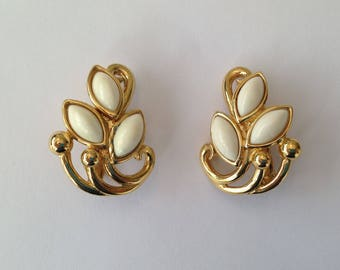 Vintage 1960s Trifari Goldtone and White Cabochon Clip On Earrings.