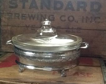 Vintage Pyrex clear Glass casserole dish and lid silverplate stand/holder with handles