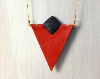Bold red triangle leather necklace.