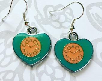 Popular brand teal & peach heart shape enamel earrings on nickel free ear wires.