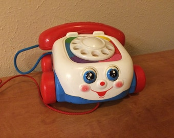 Vintage Fisher Price pull toy telephone with moving eyes, vintage 1990s toddler toy preschool
