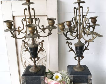 A stunning pair of weathered and worn French gilded spelter and black Onyx candelabra
