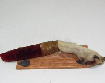 Coyote foot handle knife with a glass blade....E674....Ornamental, replica, primitive tool..