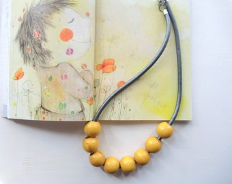 Wooden necklace with colored beads and leather