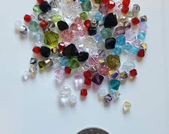 129 various sizes and colors Swarovski Crystal Bicone Beads