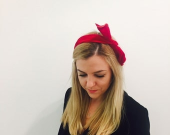 Hand made hairband with an adjustable bow