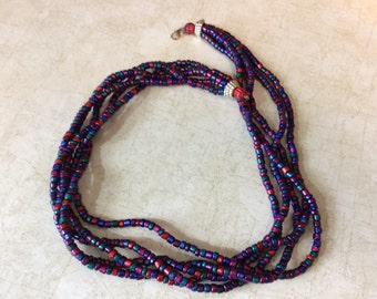 5 stranded multi colored lightweight resin beaded necklace.  Lovely 1980 classic perfect for any occasion or outfit.