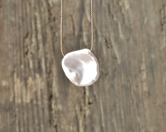 Freshwater pearl necklace. Minimalist necklace with a petal shaped freshwater bead. June birthstone.
