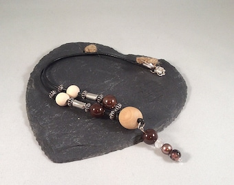 Brown and Wooden Beaded Necklace on Leather Chord