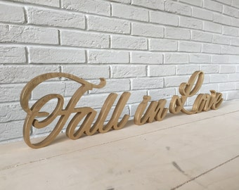 Fall in love sign. Love gold sign. lovely home decoration. Standing sign or a wall decor sign, romantic saying, love