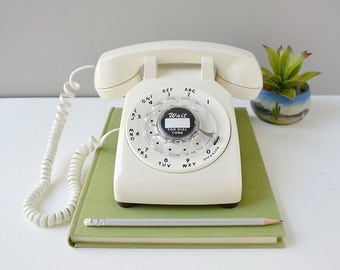 Vintage rotary phone; working rotary dial telephone; retro phone in white; 1970's rotary dial desk phone