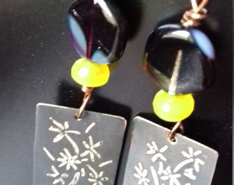 Brass earring with engraving on metal