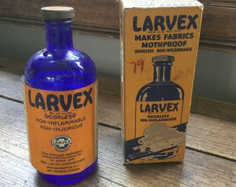 Vintage Antique 30s blue bottle Larvex and original box.