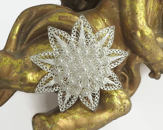 Sterling silver filigree flower brooch with extremely fine wire work with a multitude of tiny flowers in the center, hand made, circa 1940s