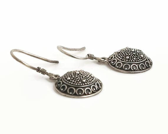 Sterling silver domed circle drop hook earrings with ethnic type design circles, balls, and lines, plain backs, stamped 925