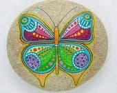 Butterfly. Mandala Stone. Painting on stone. Adriatic Coast. Italy.