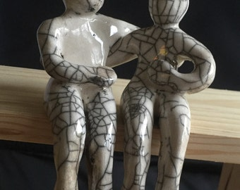 Small Raku Ceramics Couple. Unique Raku sculpture made of two separate figures hugging.