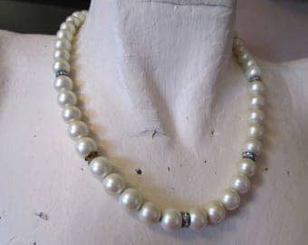 "vintage faux pearl necklace on chain with silvertone clasp 18""long with 8 rhinestone bands good condition"