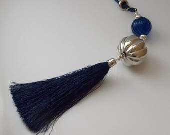 Large navy blue necklace, with silky pompon and big silvered pearl.
