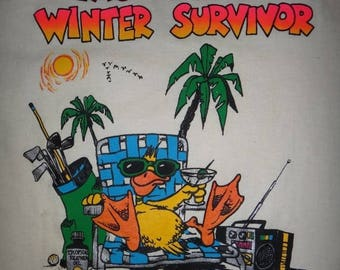 Vintage 1987 LAS VEGAS Winter Survivor T Shirt Vtg Surf Beach Picnic  Surfing Duck Funny 80s tee
