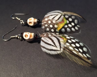 Skull feather earrings with black and white stripes and polka dots