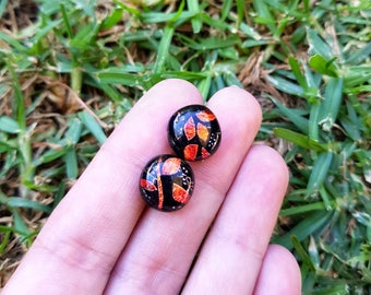 Dichroic glass red orange yellow black colour change stud earrings. Hypoallergenic stainless surgical steel posts