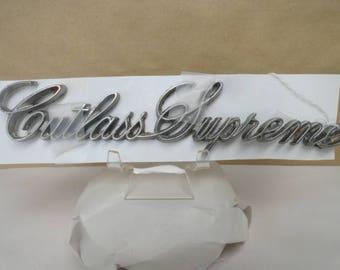 Vintage Cutlass Supreme car emblem 1960'--1970's made of chrome.