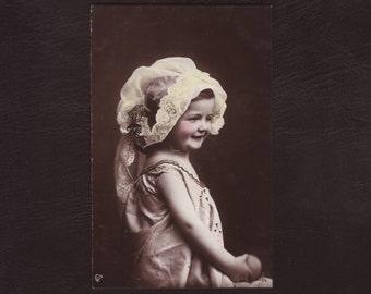 Little girl in unusual art nouveau headdress, German hand tinted photo postcard - Children, rppc,hat, antique greeting card - 1905 (V4-68)