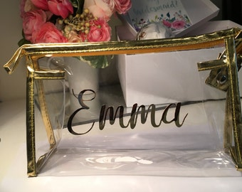 "Personalized clear cosmetic bag. Zipper closure, clear vinyl makeup bag monogrammed or personalized with ""bride"" or bridesmaid's names."