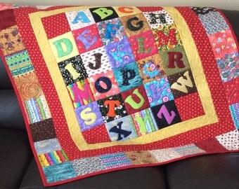 Alphabet lap quilt, multicoloured kids lap quilt, crib quilt with abc, alphabet play quilt, red quilt, scrappy child's quilt