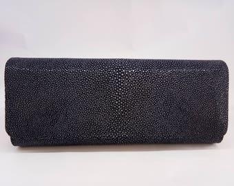 Clutch bag in dark blue stingray leather