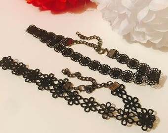 2 black delicate chokers with flower designs