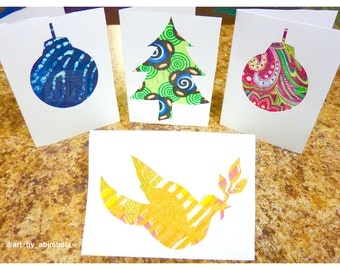 Holiday greeting cards in delightful fabrics with unique designs