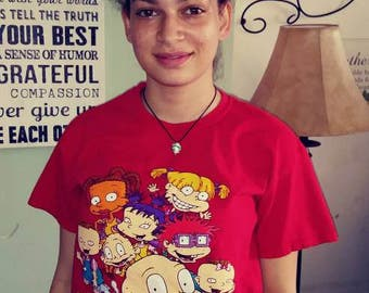 On sale!Medium adult Rugrats shirt order a additional top and pay just 1 dollar in additional shipping plus cost of item